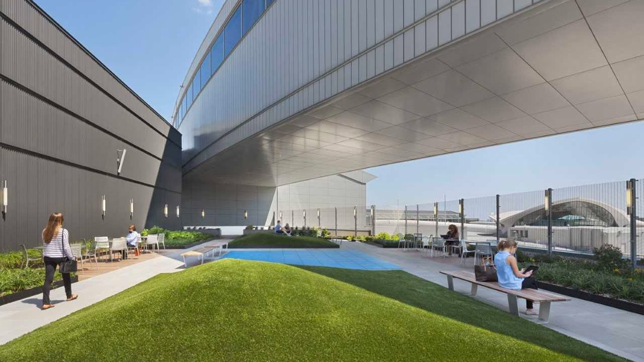 Terminal 5 Skywalk with outdoor seating and grassy area