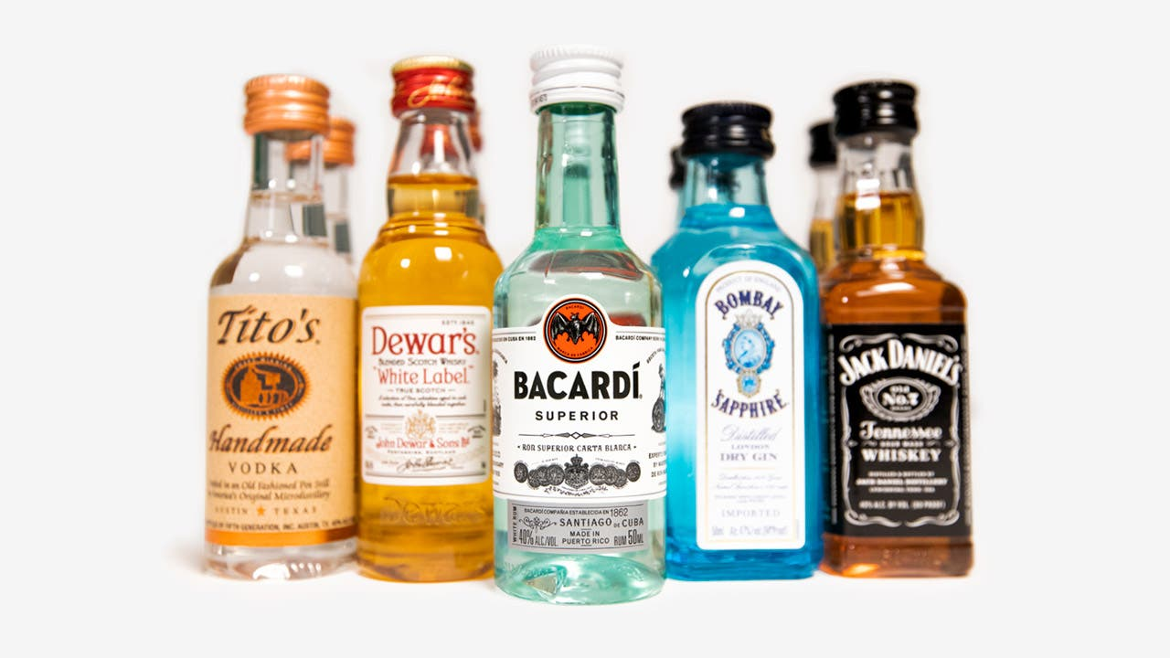 single shots of Tito's vodka, Dewar's White Label scotch, Bacardi Superior rum, Bombay Sapphire gin and Jack Daniel's whisky